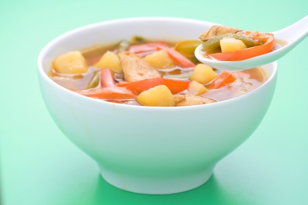 Chinese chicken soup with potatoes and peppers photo