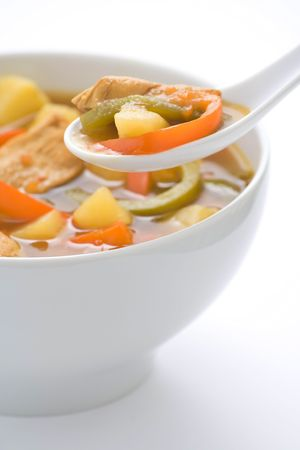 broth: Chinese chicken soup with potatoes and peppers Stock Photo