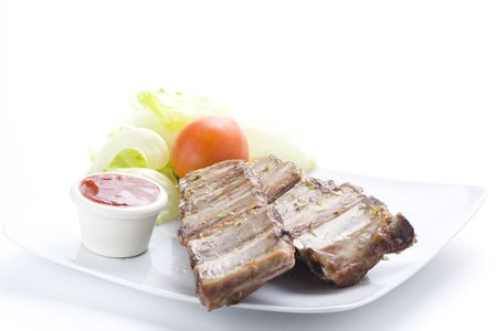 fresh american ribs oregano bbq sausace isolated photo