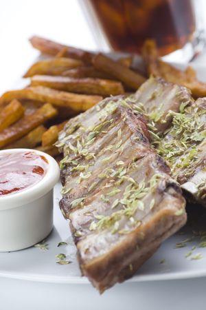 fresh american ribs oregano bbq sausace isolated photo