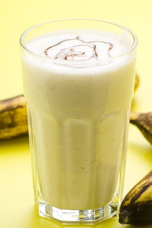 fresh fruit milk shake banana and caramel isolated photo