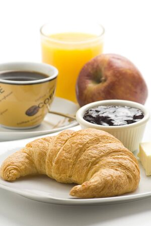 delicious continental breakfast of coffee and croissants isolated photo