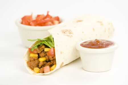 delicious fajitas beef lettuce tomato pepper corn isolated photo