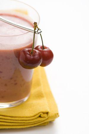 a delicious cherry milkshake isolated over white photo
