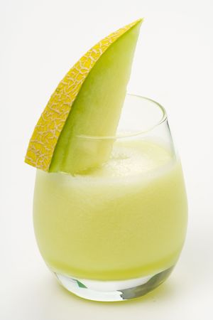 a delicious melon milkshake isolated over white photo