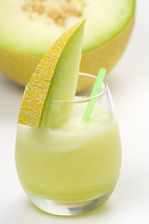 melons: a delicious melon milkshake isolated over white Stock Photo