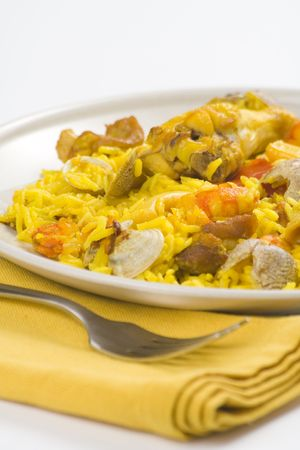 delicious seafood paella and chicken rice yellow isolated photo