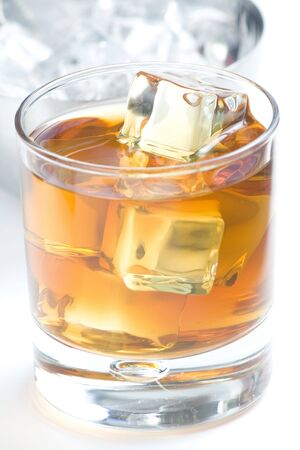 alcoholic beverage whith ice cubes isolated over white Stock Photo
