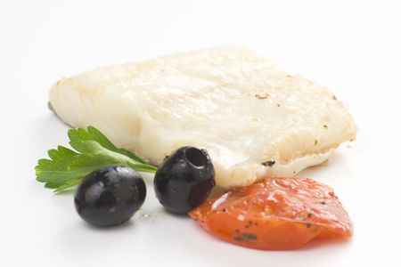 fillet of cod baked tomatoes zucchini black olives isolated Stock Photo - 5264009