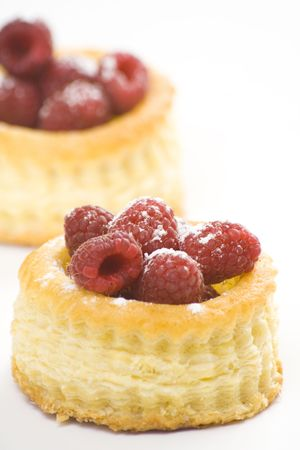 raspberry pastry cream and decorated with lemon parsley isolated photo