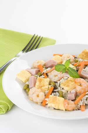 Plate of shrimp fried rice peas ham omelette isolated photo