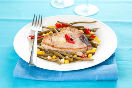 tasty tuna steak prepared whith fresh vegetables photo