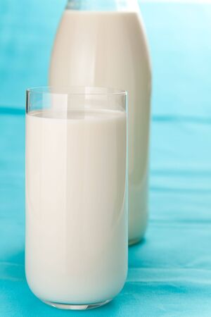 Fresh glass of milk isolated over white background photo