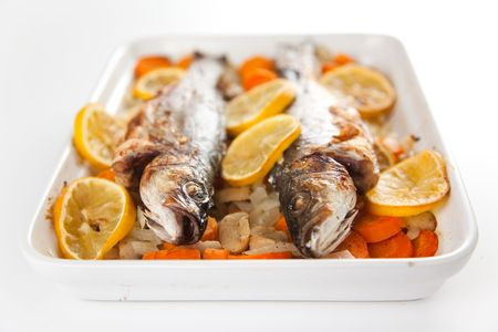 fresh seabass baked with vegetables photo