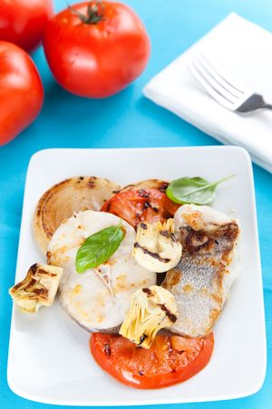 hake: fresh slice of hake baked with vegetables Stock Photo