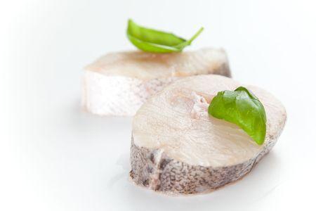 Fresh hake slice isolated over white background