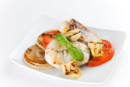 whitefish: fresh slice of hake baked with vegetables Stock Photo