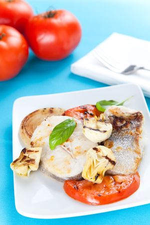 fresh slice of hake baked with vegetables photo