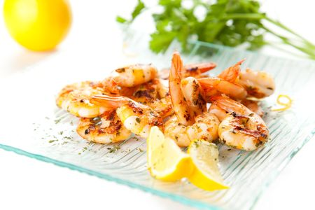 tasty grilled prawn salad with lemon and parsley photo