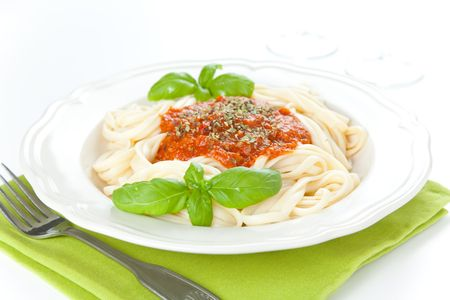 home made bolognese noodles isolated over white photo