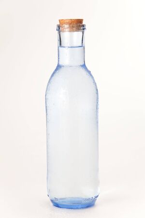 cool and fresh bottle of water isolated