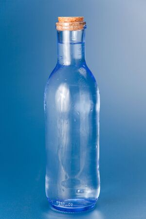 cool and fresh bottle of water isolated photo
