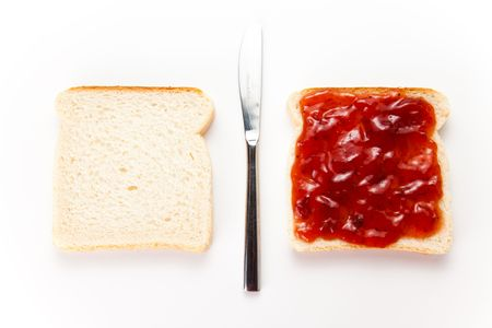delicious slice of bread with strawberry jam photo