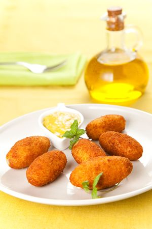 croquettes: ham and cheese croquettes typical Spanish cuisine