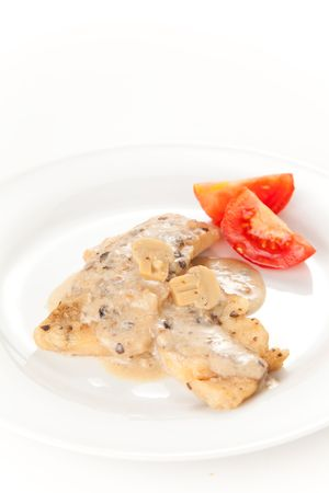 hake fillets with cheese sauce and mushrooms photo