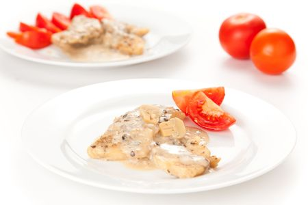 hake: hake fillets with cheese sauce and mushrooms