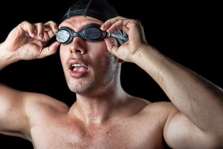 swimmer athlete facing the pool over black background photo