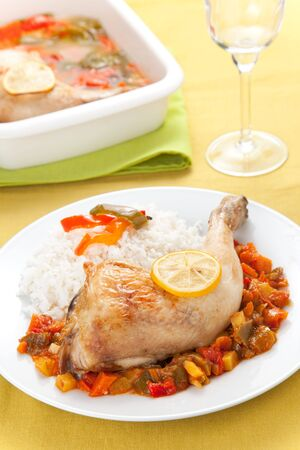 roast chicken with red and green peppers isolated photo