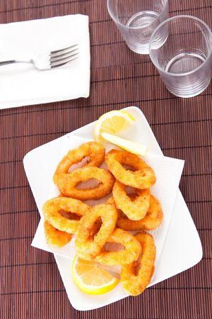 calamares: plate of tasty fried calamari with lemon