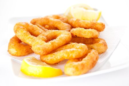 calamares: plate of tasty fried calamari with lemon