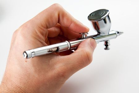 silvery airbrush for a paint over white background Stock Photo