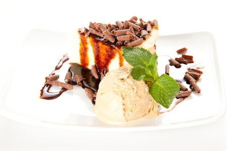 cheesecake  with ice cream, chocolate shavings and mint Stock Photo