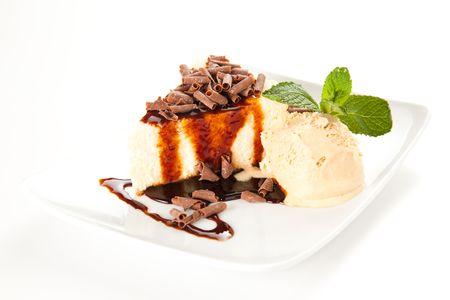 cheesecake  with ice cream, chocolate shavings and mint photo