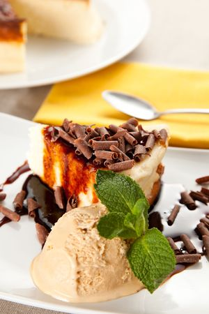 cheesecake  with ice cream, chocolate shavings and mint photo