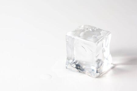 translucent ice cube isolated over white background Stock Photo - 6715528