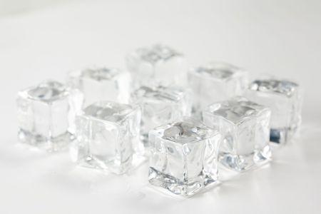 translucent ice cube isolated over white background Stock Photo - 6715536