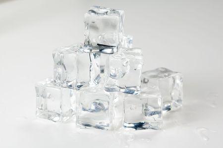 translucent ice cube isolated over white background Stock Photo - 6715537