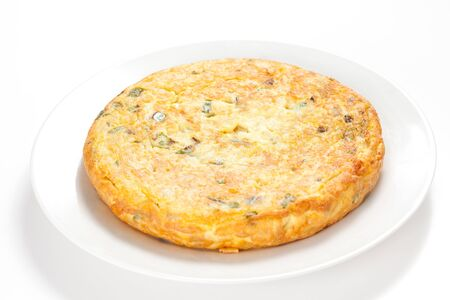 potato omelette with olive oil and green pepper isolated photo