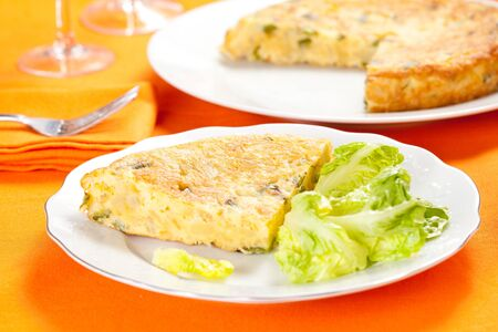potato omelette with olive oil and green pepper isolated