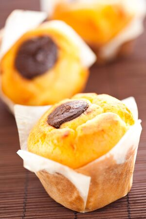 choco chips: tasty homemade muffin filled with black chocolate