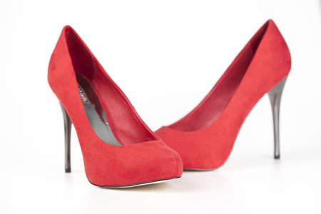 red shoes: Red high heels isolated over white Stock Photo