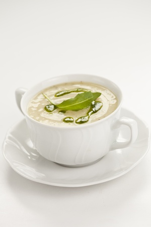 sopa: tasty home made leek soup on white cup