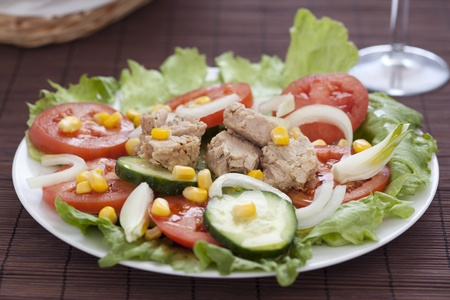 tasty tuna salad lettuce tomato cucumber onion photo