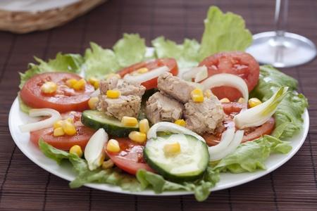 tasty tuna salad lettuce tomato cucumber onion photo