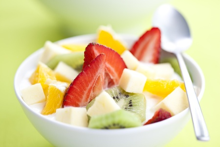 delicious fruit salad with chunks of fruit and yogurt photo