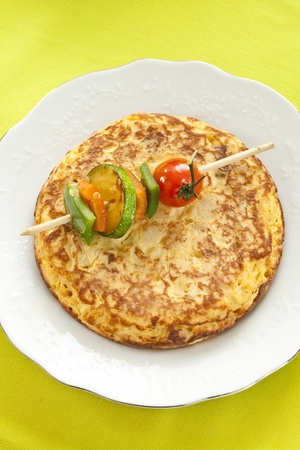 omelet: tasty potatoes omelette with grilled vegetable skewer Stock Photo